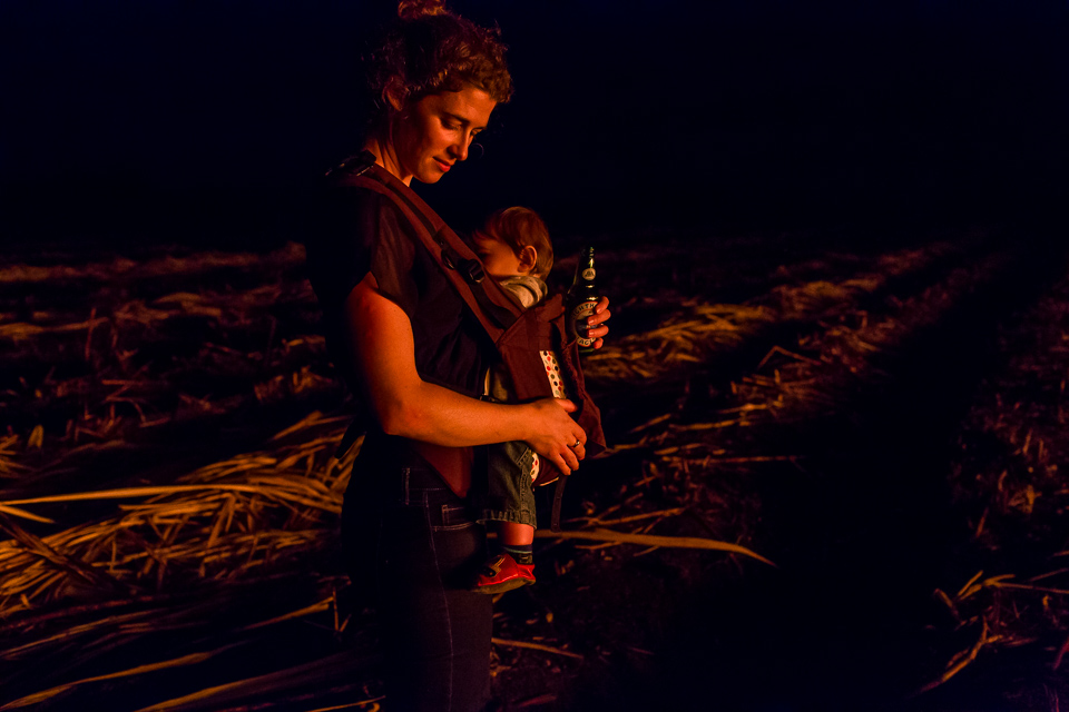 mother with baby in firelight