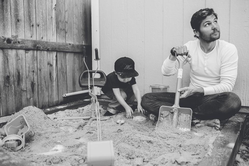 dad son sandbox shovel