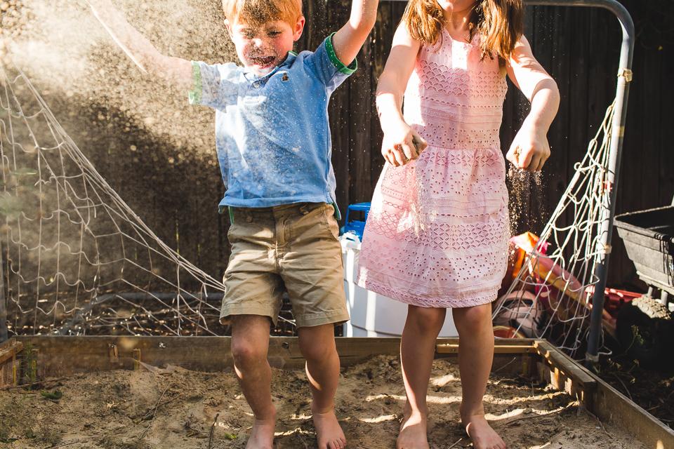 children throwing sand box denver family photographer