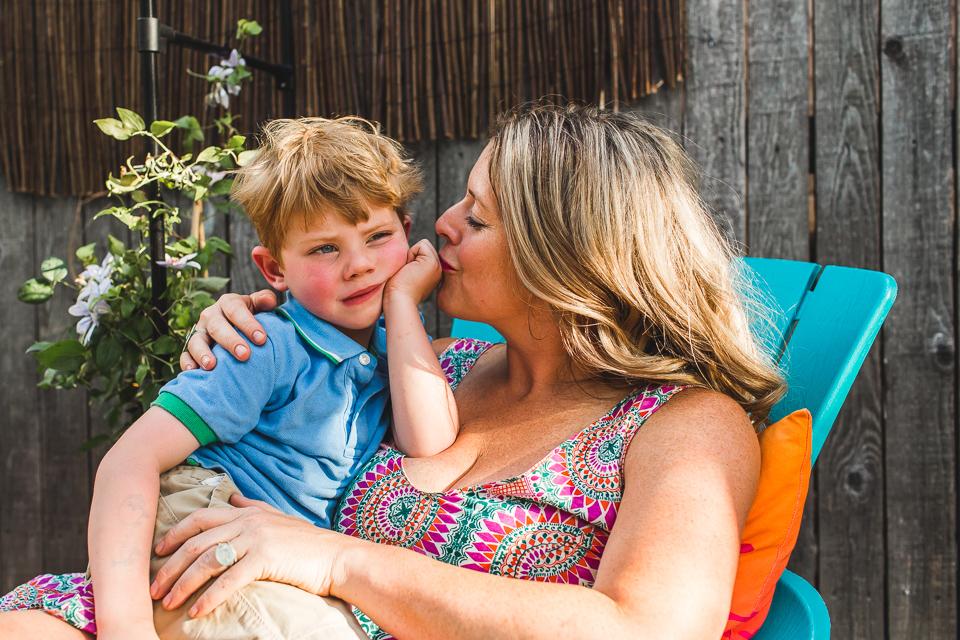mom kissing little boy son denver family photographer