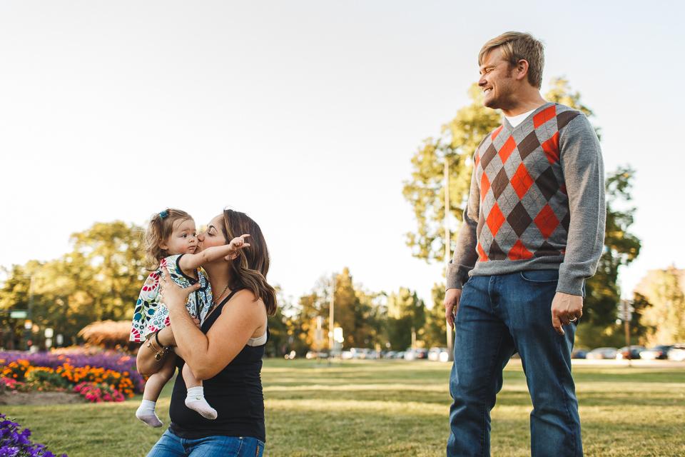 mom kissing daughter in park denver colorado
