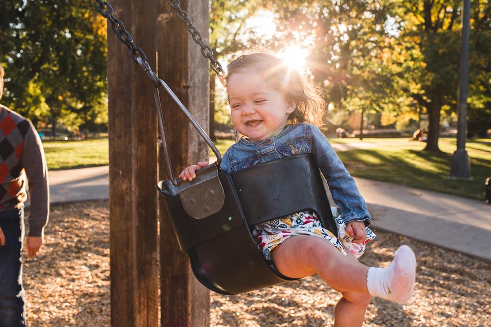 little girl swinging in washington park denver colorado