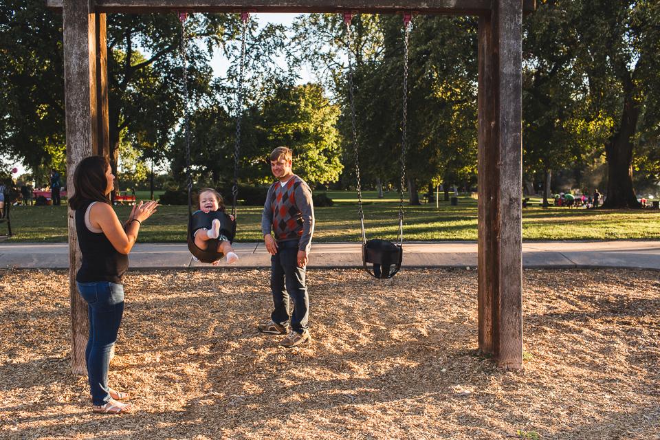 family playing on swings washington park denver colorado