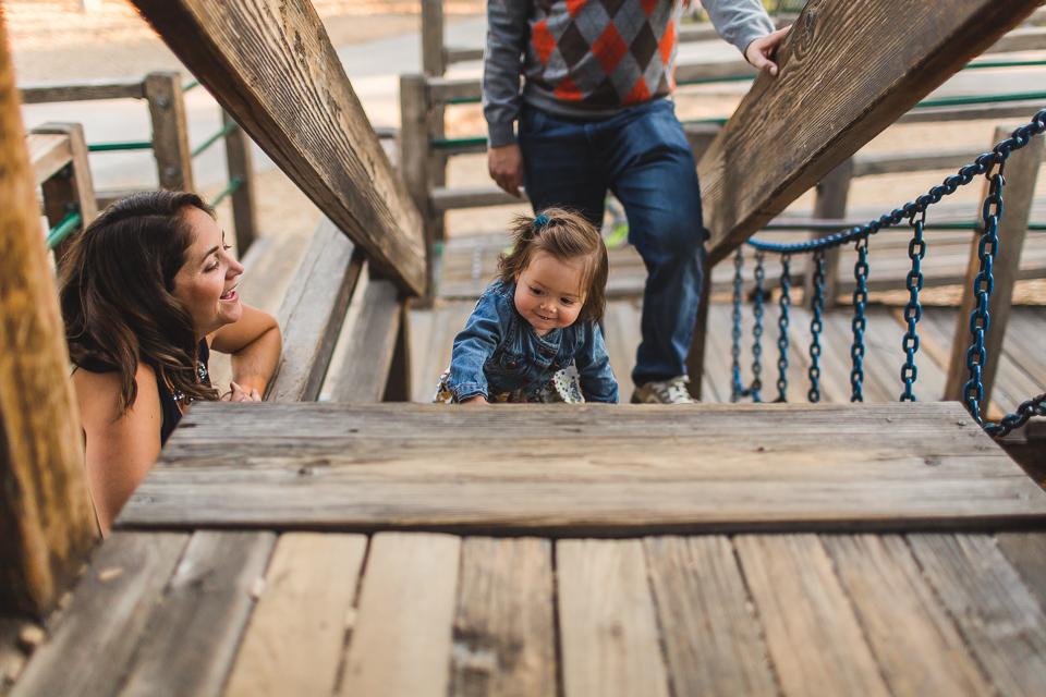 girl crawling at playground at washington park denver colorado