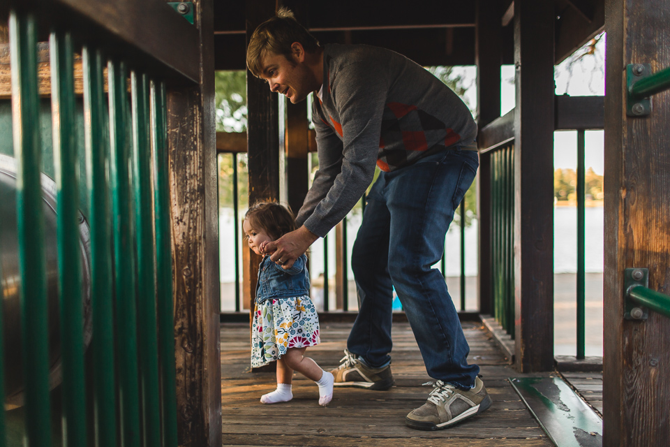 dad playing with daughter at washington park denver colorado