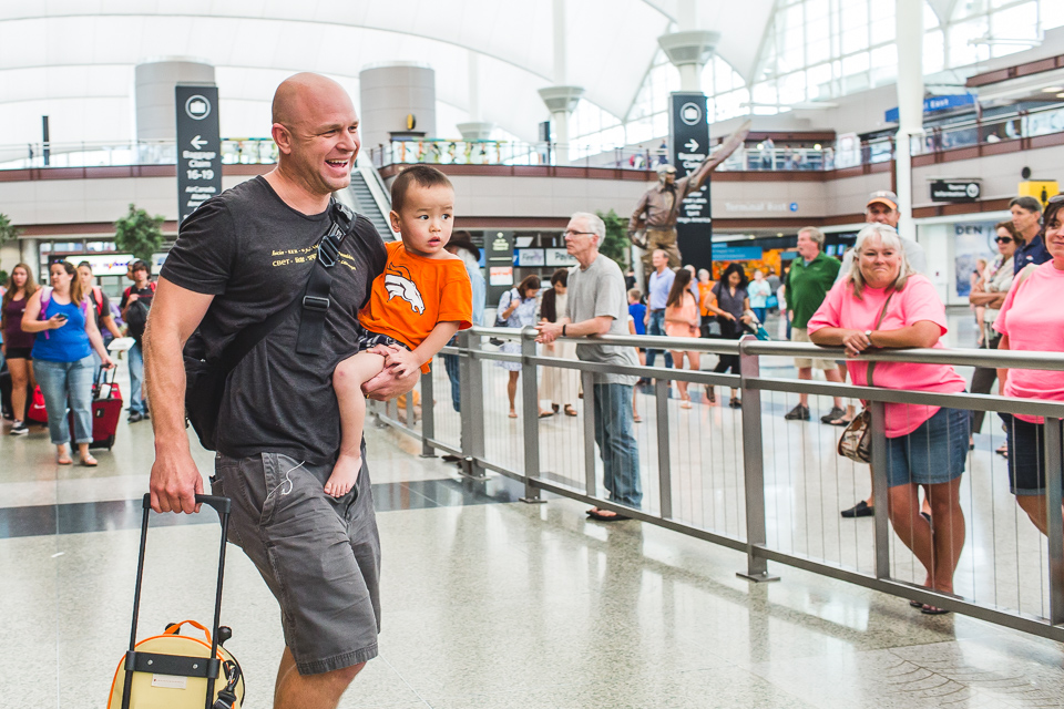 dad and son meeting family at denver international airport