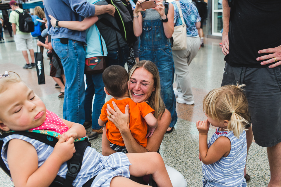 mother hugging adopted son for first time colorado