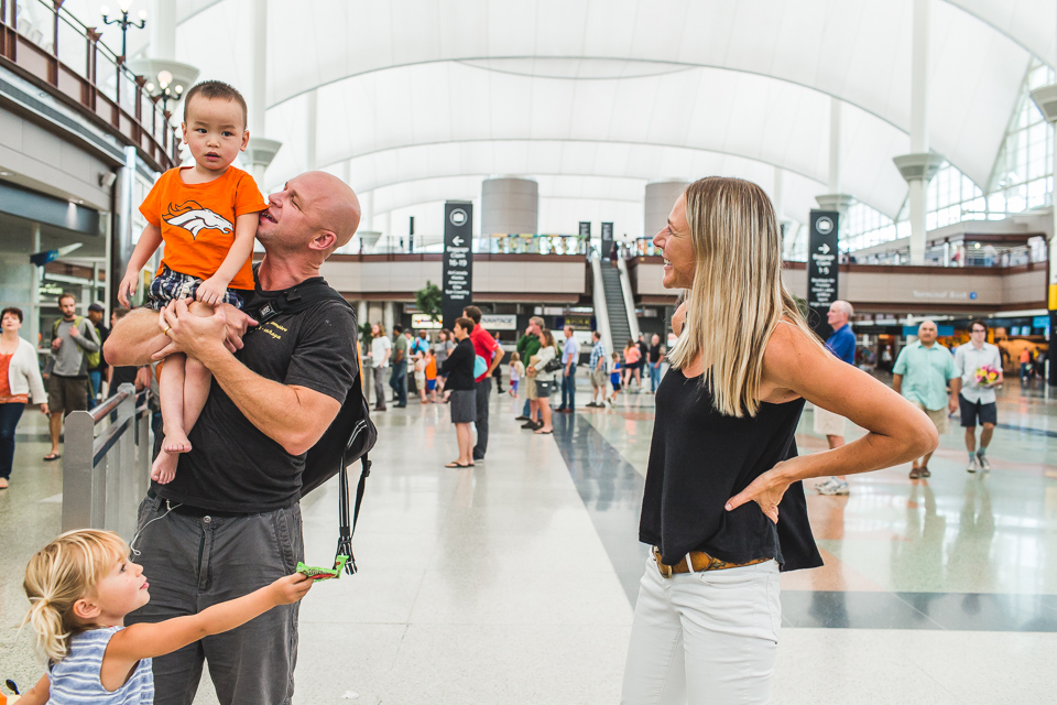 family united with adopted son at airport