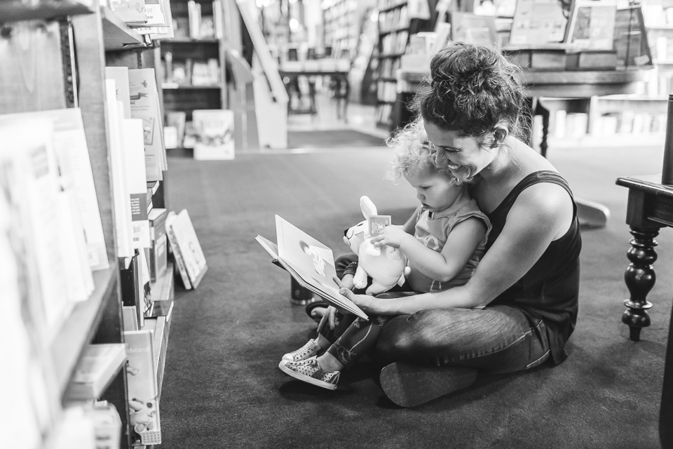 mom reading book to daughter in tattered cover denver