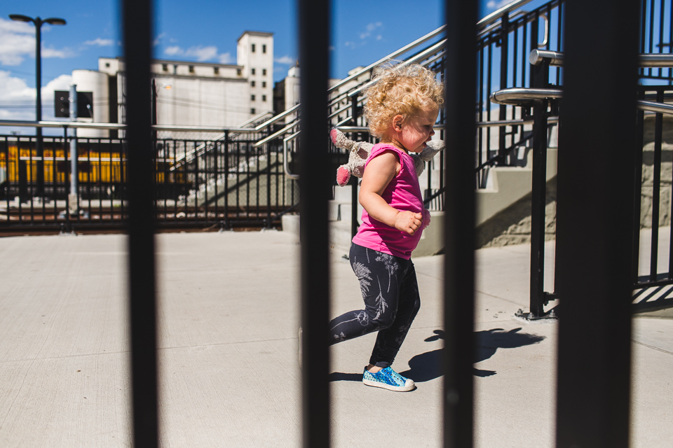 little girl runs through denver train station