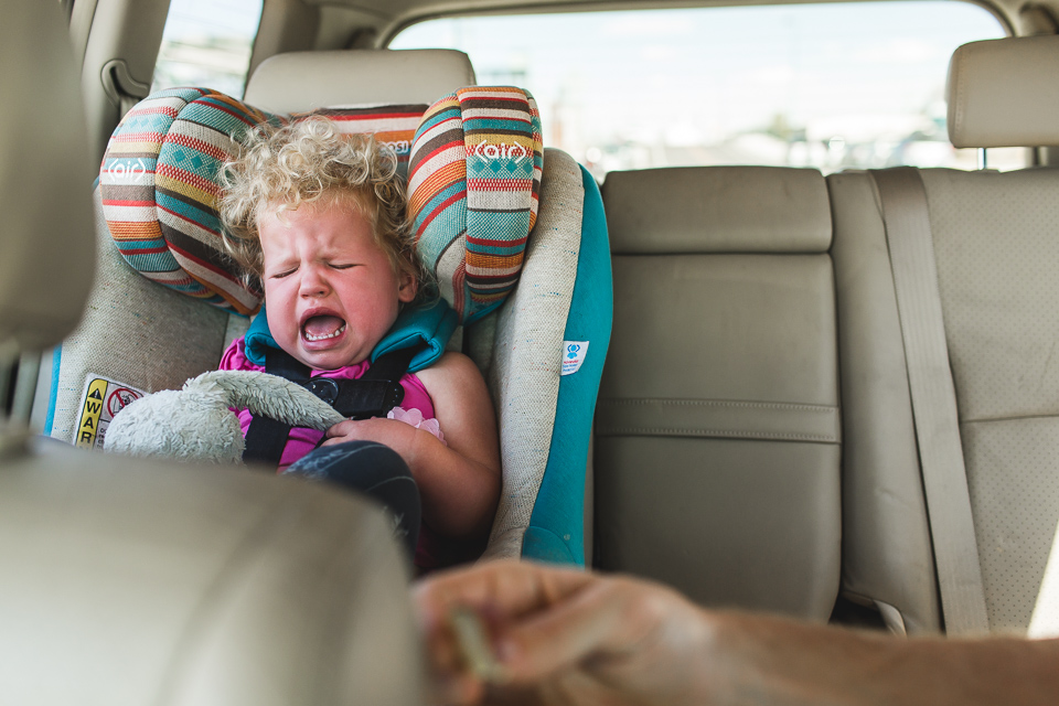 little girl screaming in car seat