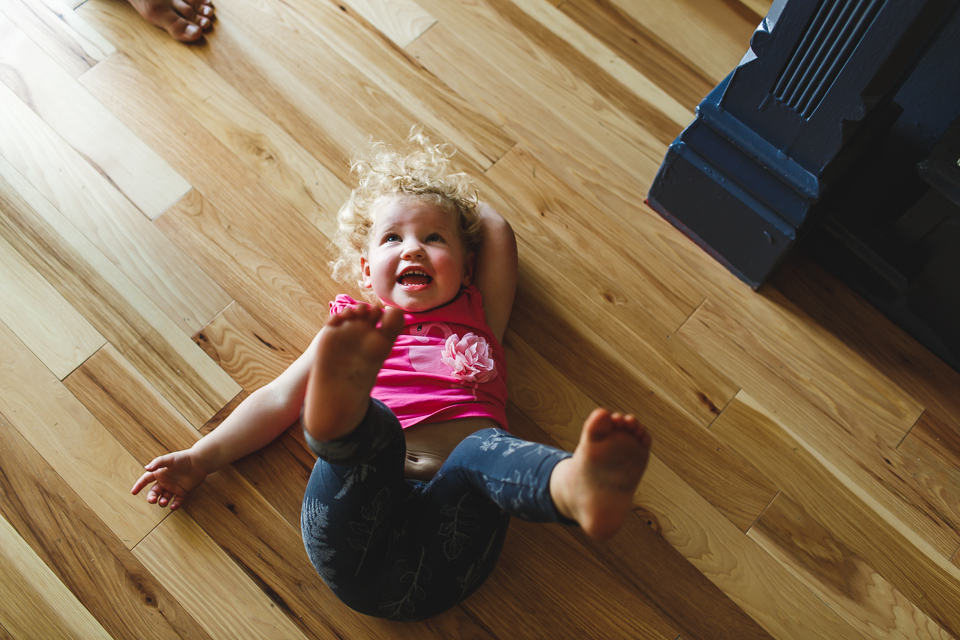 little girl playing on floor in her home in denver