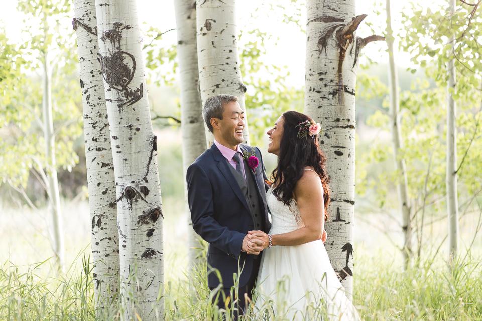 bride groom laughing at wedding in aspen colorado
