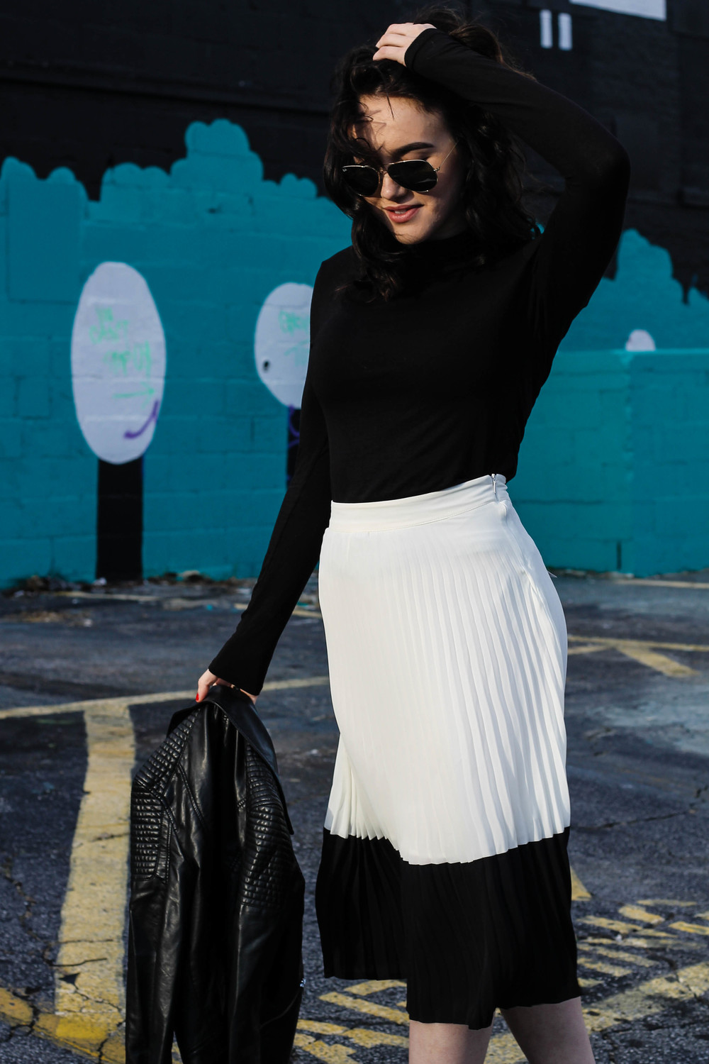 F21 pleated midi skirt ( here )  H&M faux leather jacket similar ( here ) & ( here )  H&M turtleneck similar ( here ) & ( here )  Cathy Jean pumps     Photos by Kristina Alexis