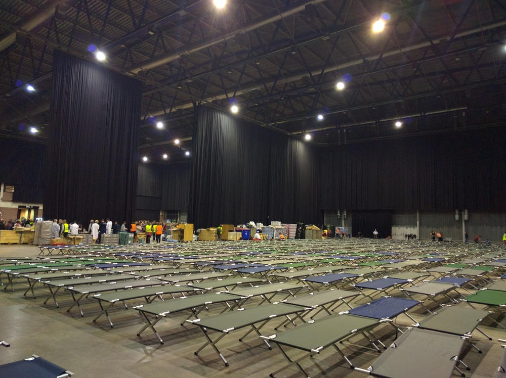 What half of the event hall looked like before people began claiming their cots. In this room alone, there were around 800 people.