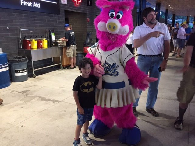 Abe Percansky-Segal and Mudonna T. Pig (The Saint Paul Saints Mascot) / CHS Field / Saint Paul, Minnesota / June 10th, 2015 / Photo by Jesse Segal
