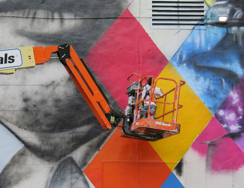 The blank white wall becomes the 'canvas' for a mural by Brazillian artist Kobra- with multiple images of Bob Dylan.