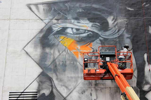 If you drive, walk, bus or bike downtown or use light rail, you can watch the new Bob Dylan mural take shape over the next two weeks. (Photo by Bailey Cahlander)