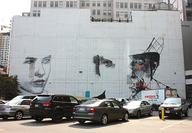 The formerly blank white wall is becoming a triptych of Dylan through the years. (Photo by Bailey Cahlander)