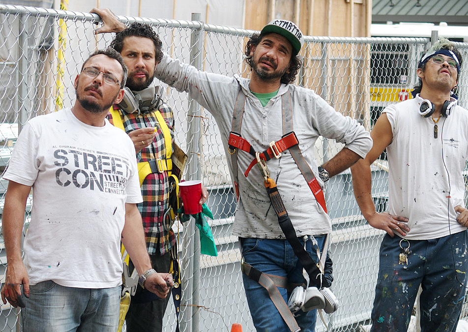 Artists Marcos Rafael da Silva, Agnaldo Brito Pereira, Eduardo Kobra and Yuya Nigishi stepped back from painting to get a longer view of the piece on August 27, 2015.