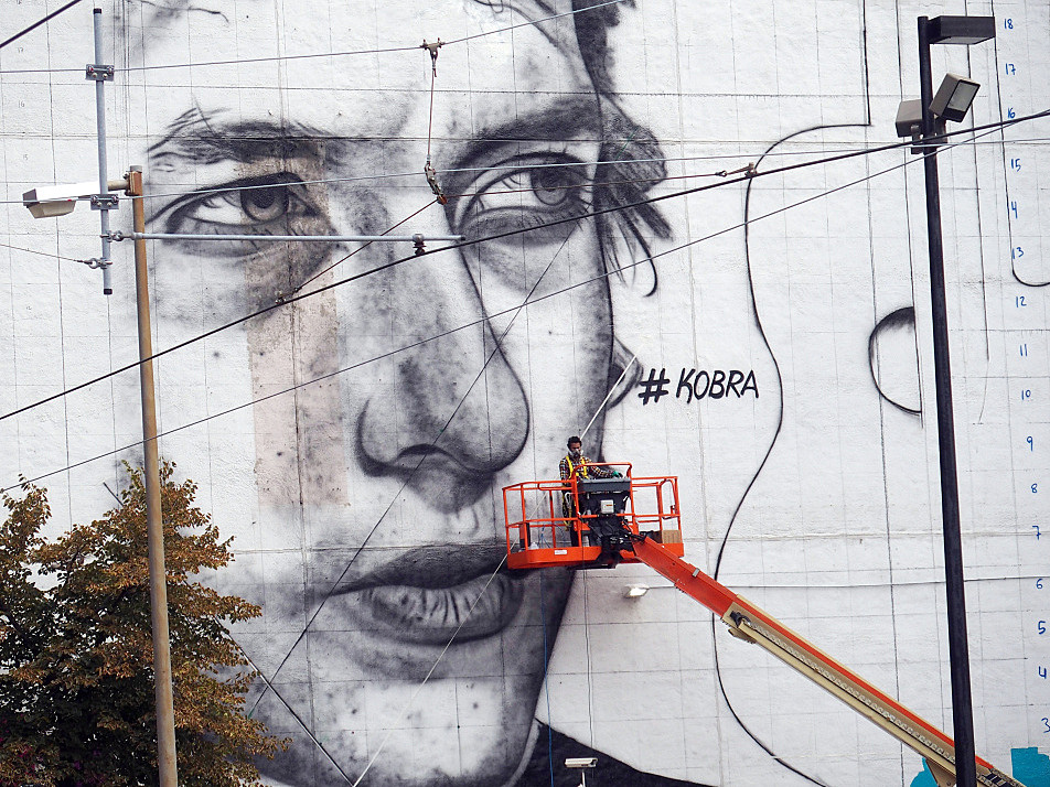 Early in the work on the mural, an image of the young Bob Dylan took shape on the side of the 15 Building at 5th and Hennepin in downtown Minneapolis on August 27, 2015. The artist's name -- Kobra -- appears as a hashtag.