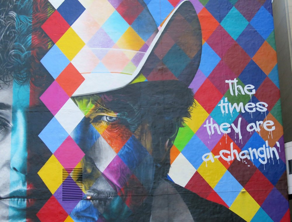 The blank white wall facing the corner of 5th and Hennepin Av has transformed into a mural by Brazilian artist Eduardo Kobra and crew. Monday 9/07/2015