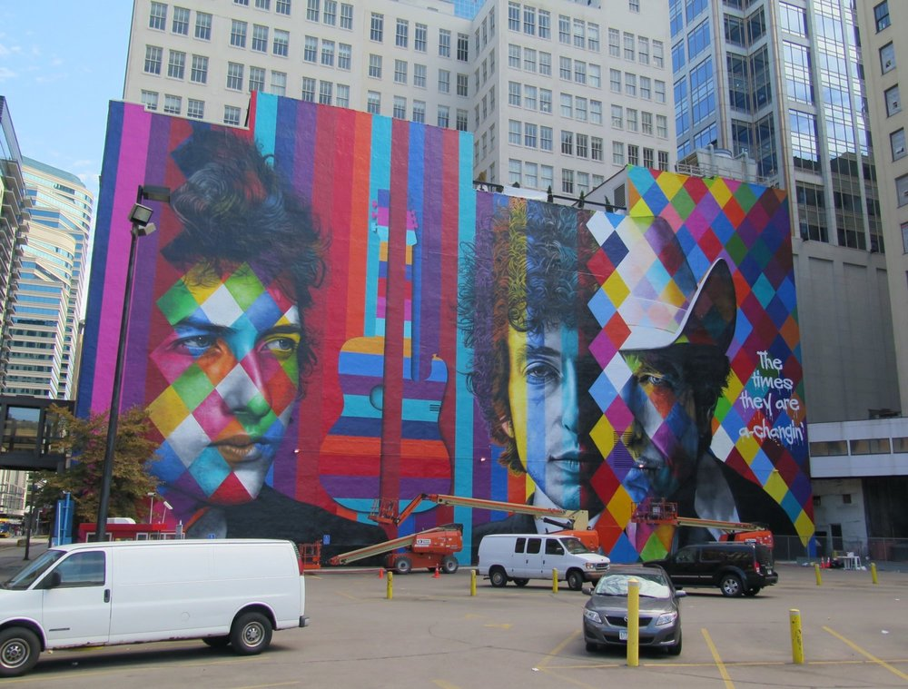 The blank white wall facing the corner of 5th and Hennipen Av has transformed into a mural by Brazilian artist Eduardo Kobra and crew. Monday 9/07/2015 - last in time lapse series