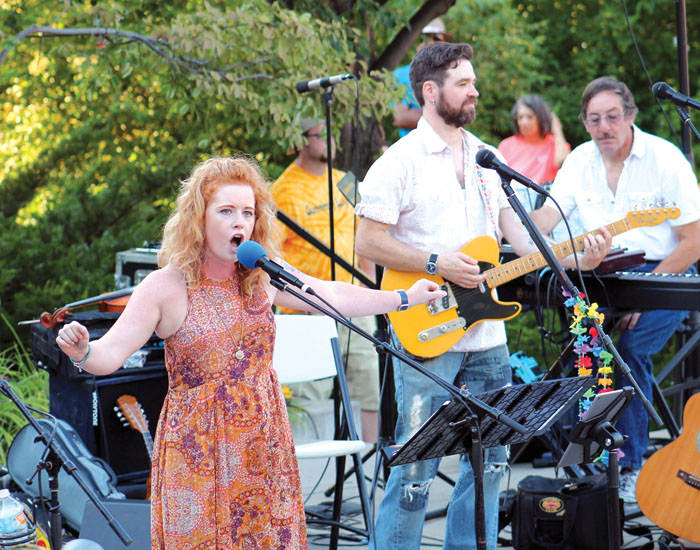 "Singer Hailey Woodfill impressed the Summer of Love audience with her versions of ""White Rabbit"" and ""Somebody to Love"" at the Summer of Love concert. (Sun Sailor staff photo by Seth Rowe)"