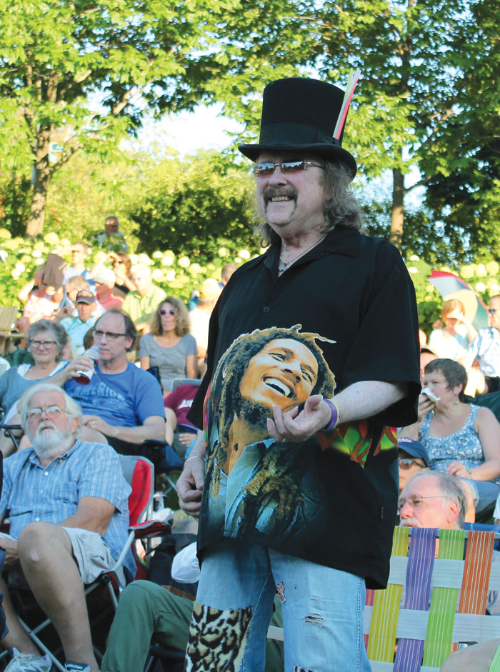 "St. Louis Park resident Jim McDonough, Jr., plays the air guitar to the song ""Somebody to Love"" July 29 in Wolfe Park. (Sun Sailor staff photo by Seth Rowe)"