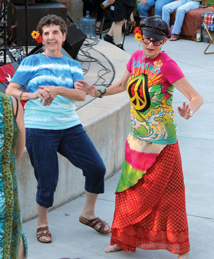 Summer of Love concert attendees dance beside the stage at Veterans' Memorial Amphitheater. (Sun Sailor staff photo by Seth Rowe)