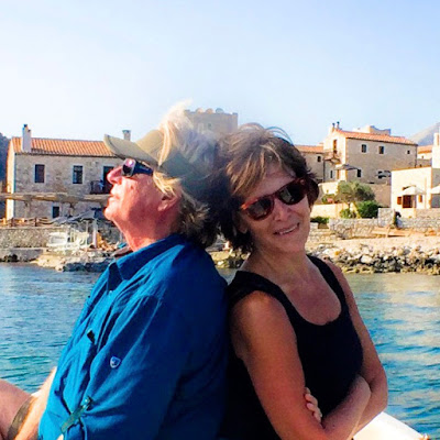 On the water in Hydra, Greece: Kevin Odegard with Susan Casey.