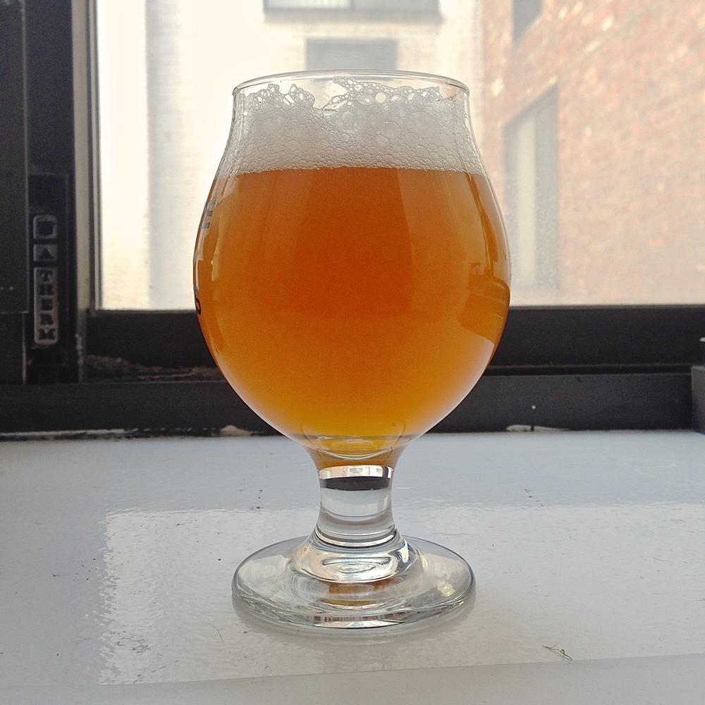 Beautiful beer on an ugly window sill.