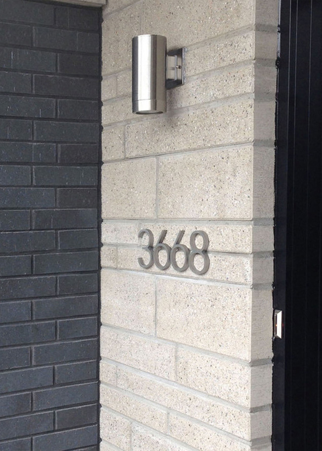 3668 - We decided to use brushed stainless to match the finish of the wall sconce and the hardware. The light ensures that the address numbers remain visible at night.Material: Stainless steelFinish: Vertical brush.Thickness: 1/2 inchHeight: 5-inch numbers