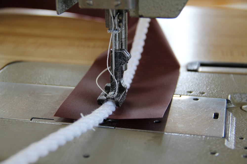"""This machine has a """"walking foot"""" that allows us to stitch a length of line onto fabric. Still, the task requires finesse to drive the needle directly through the center of the line and not swerve in either direction.Photo by Bonnie Obremski"""