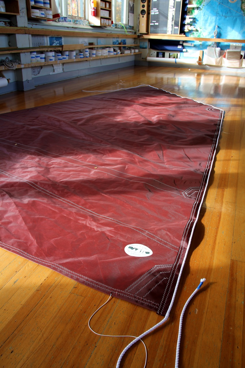 Here the sail is finished being stitched with sewing machines and ready to be finished by hand.Photo by Bonnie Obremski