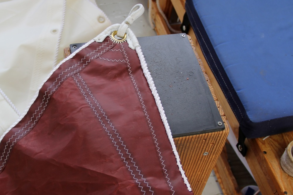 This is the peak corner of the sail. A nylon loop covered in leather is the place where the spiked end of the sprit will go. Photo by Bonnie Obremski