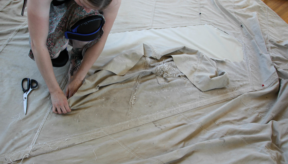 """In a """"TV screen"""" patch, the damaged material is removed once the new material is sewn on. There should be at least a one-inch overlap of old and new material along the edge of the patch. The cut edge of the old material should be folded over and sewn or heat-sealed with a hot knife to prevent fraying. Photo by Bonnie Obremski."""