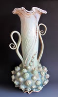 Encrusted Urn  19x9x9  ceramic  $525_jpg.jpg