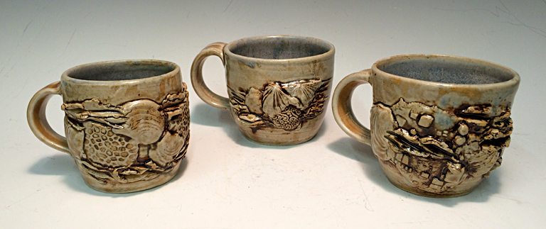 Fossils of the Future Mugs  ceramic  $20 ea..jpg