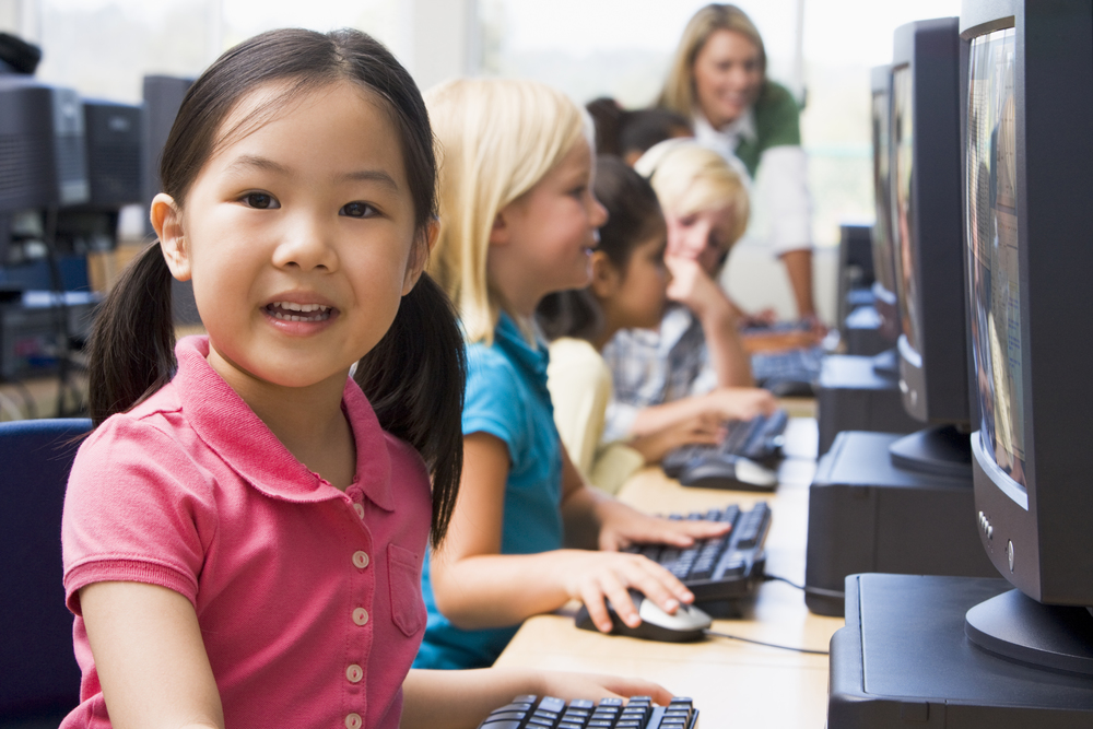 shutterstock_77123362 children with computers.jpg