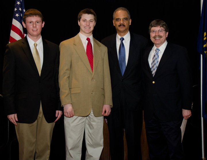 Brothers Austin Markus James and Dylan Klapmeier with Attorney General Eric Holder, and University of Montana Honors College  Dean McKusick.