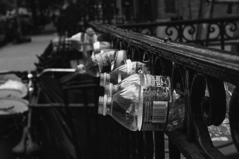 Among the beautiful architecture and classic ornamental fire escapes and railings were bottles stuffed in a very linar manner, pleasing my OCD tendencies and providing an interesting photo.
