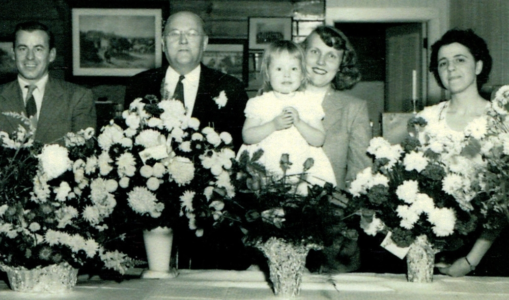 Agency's 25th Anniversary.  From left to right David F. Cowan,Millard Severson,Frances Cowan holding their Daughter Gail and Jeannie Vandenburg