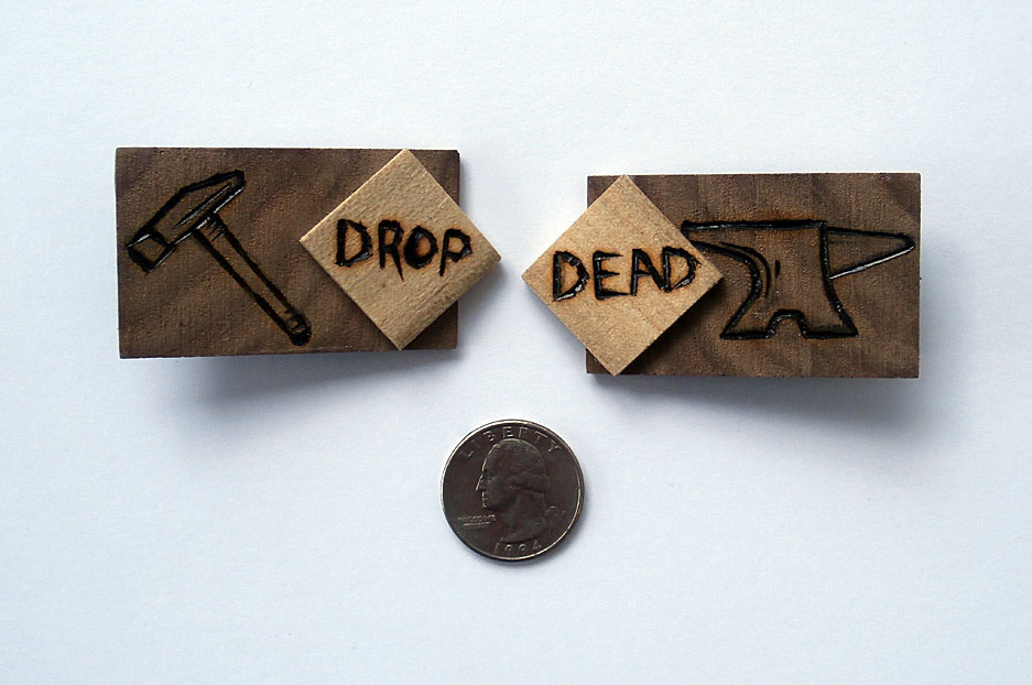 Walnut and Poplar hair clips with anvil, hammer and the words Drop Dead wood-burnt on them