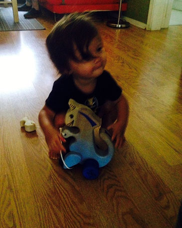 Evi playing with her dino
