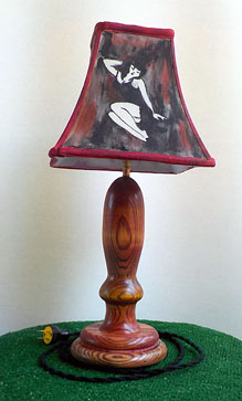 Lamp made of stained ash turned on the lathe and a hand painted shade.