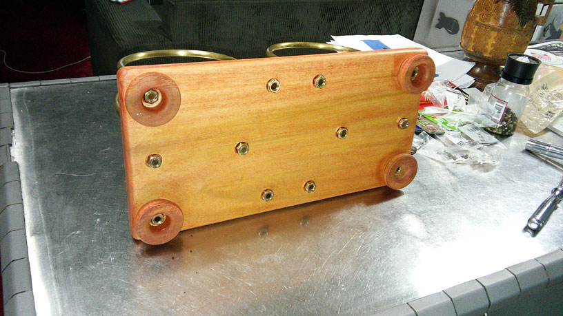 """The same record holder repaired with new wood and a Cherry Danish oil finish and a lot of """"elbow grease""""."""