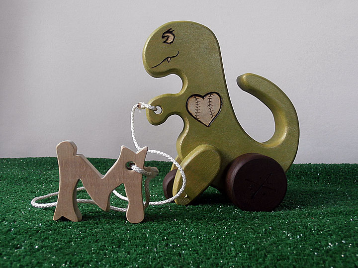 Pull dino for baby M of the baseball loving family.