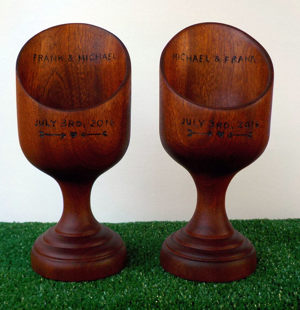 Matching mahogany wedding present vessels inscribed with names and dates to commemorate the special day.