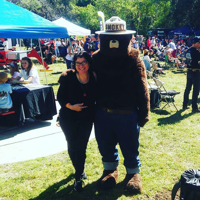 Sarah with Smokey the Bear at the Arbor Day Festival.
